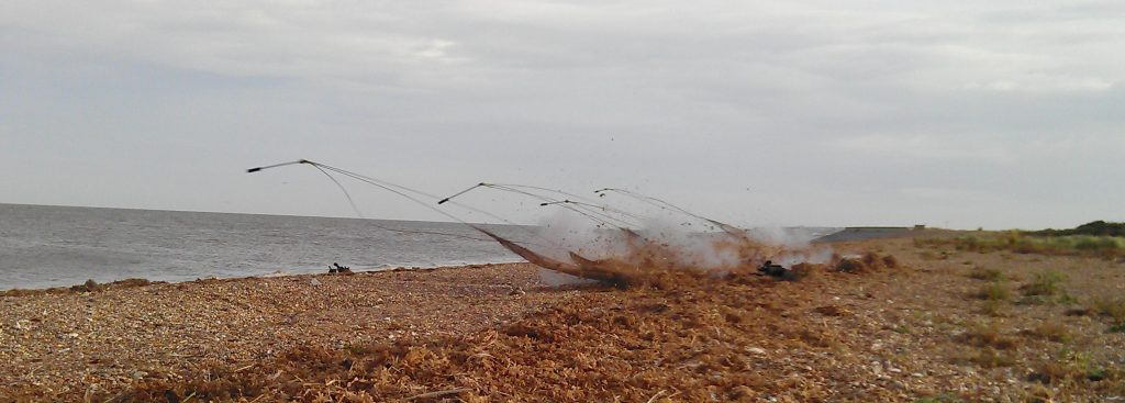 Cannon net firing on a beach