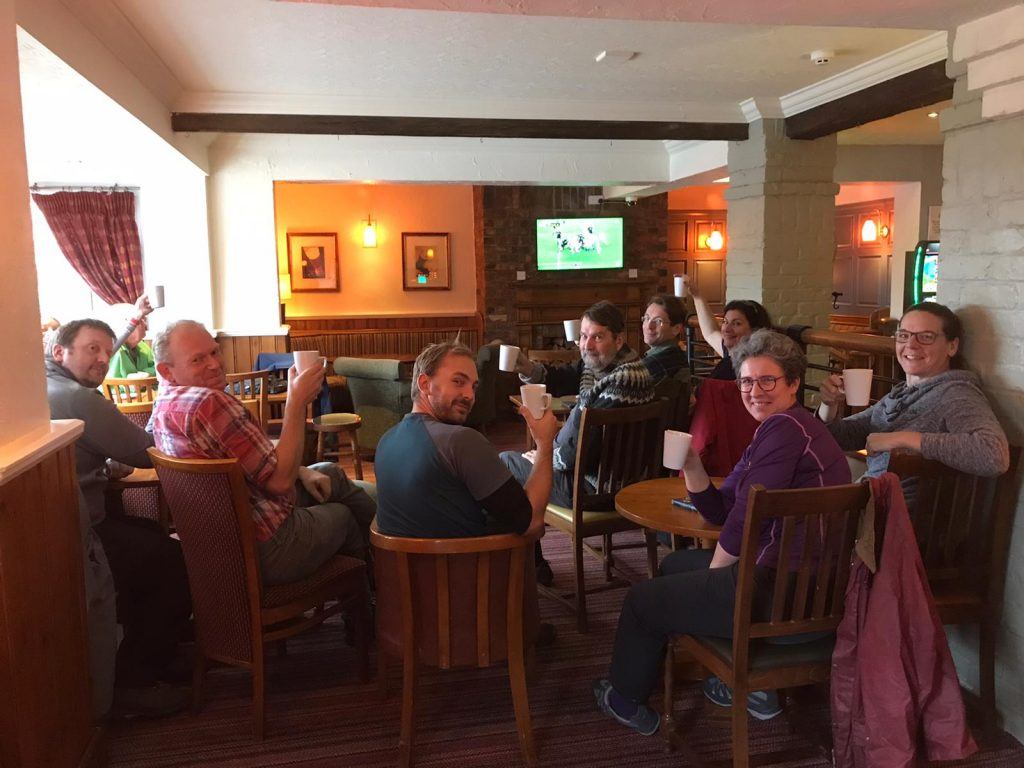 Team members watching the rugby in the pub
